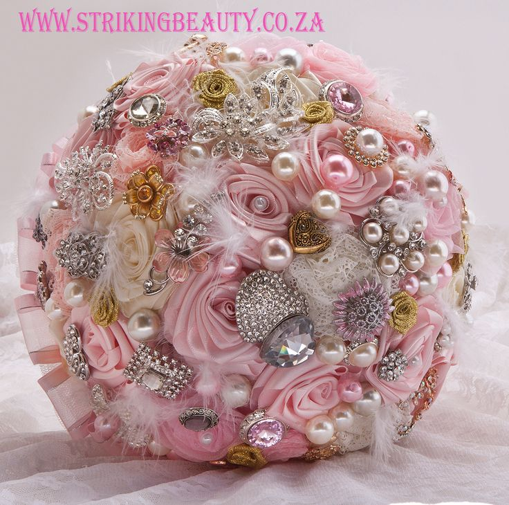 Gorgeous pink and cream brooch bouquet with hand made ribbon roses, and tulle, ribbon and lace backing from Striking Beauty - www.strikingbeauty.co.za - click on JEWELLED BROOCH BOUQUETS - susanvz@klr.co.za