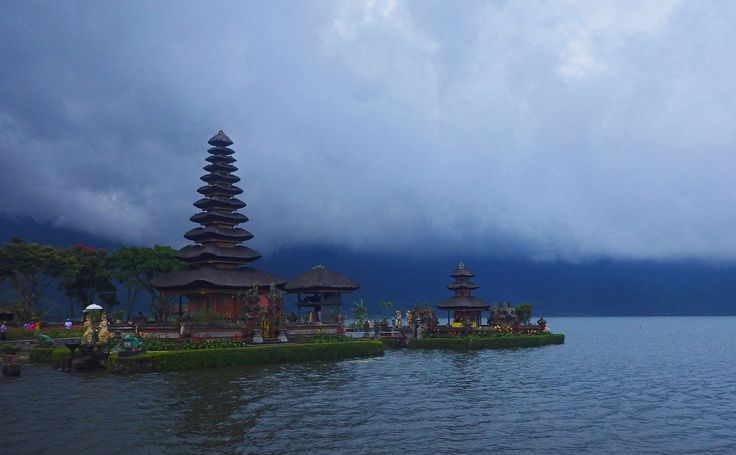 The famous temple Pura Luhur Bedugul, sits in a lake on top of a mountain in #Bali. #photography #travel. See more at www.lucymunday.com