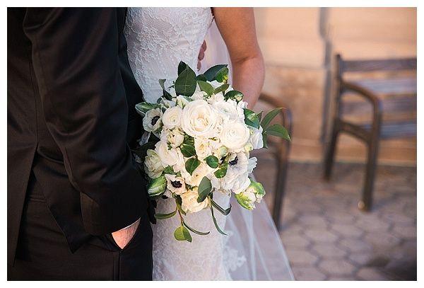 Michele + Adam, Joliet Union Station, Joliet, IL ~ Zuzu's Petals Chicago, A large, lush and textural bridal bouquet of ranunculus, parrot tulips, roses, lisianthus, anemones, and rich camelia foliage.