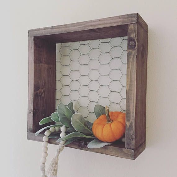 Chicken Wire & Wood Shelf, Farmhouse Decor, Wall Shelf, Square, Box Add a little farmhouse style with this adorable shelf! Perfect to display all of your cute decor or storage! Handcrafted shelf made of wood and chicken wire, ready to mount with a sawtooth hanger. If youre interested in another finish, just send me a message! Were happy to do custom orders! There will be variations in the wood, and distressing adding to the uniqueness and character of each shelf. Measures: 11 H x 11 W...