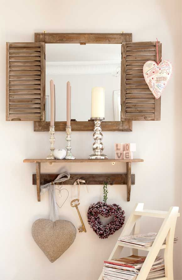 I can do this with an old window/Mirror I have from the Bahamas. It has a wall coat rack that we could put below it! Great idea!