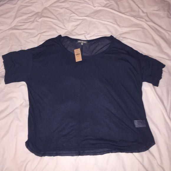 Navy Blue Slouchy Top Super cute Don't Ask Why navy blue slouchy top from American Eagle Outfitters. It's a size 0/S, and it's brand new with tags! If you have any questions, don't hesitate to ask. 💙 American Eagle Outfitters Tops Tees - Short Sleeve