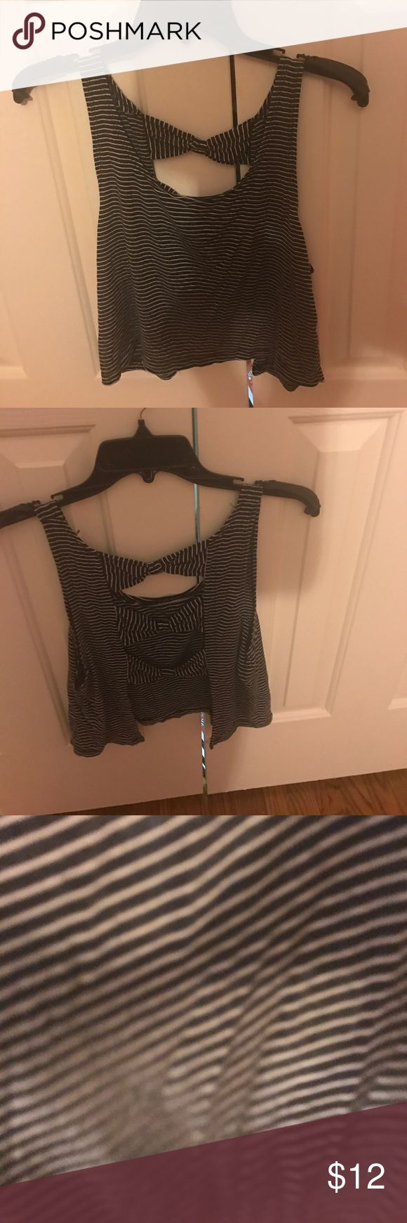 Brandy Melville bow back tank Brandy Melville navy & white stripe tank. Flowy one size. Good condition! I negotiate prices! Brandy Melville Tops Crop Tops