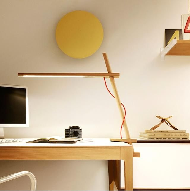 The Pablo Clamp Lamp has a light that can be raised up and down along its arm, and rotates 360 degrees around its clamping post; $350 at Horne.