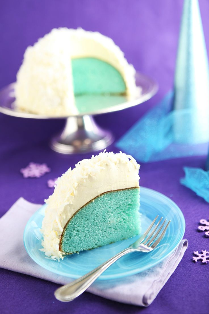 Coconut Snowball Cake -- What's inside this coconut-flake-covered dessert recipe? A berry colorful surprise for the birthday boy or girl!