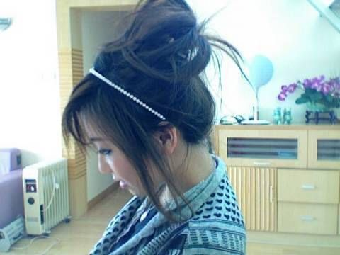 I learned how to make a mess up bun by watching this tutorial.. :) . It's the best.. this is how I discovered her!!