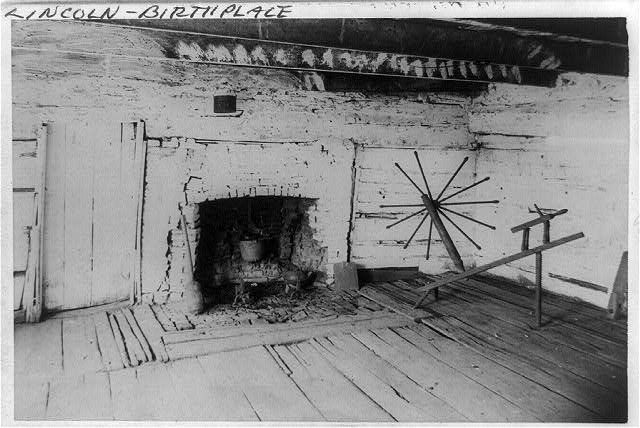 [An Interior view of the original Lincoln cabin showing the old fireplace in the west room and the old spinning jenny of Mrs. Lincoln]