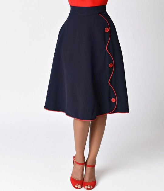 Time to throw yourself a parade, dames! The high waist Parade skirt features contrast colored piping in a swank scalloped shape down the front and piping along the bottom of the stylish skirt, with matching button details. Best part, this skirt comes with