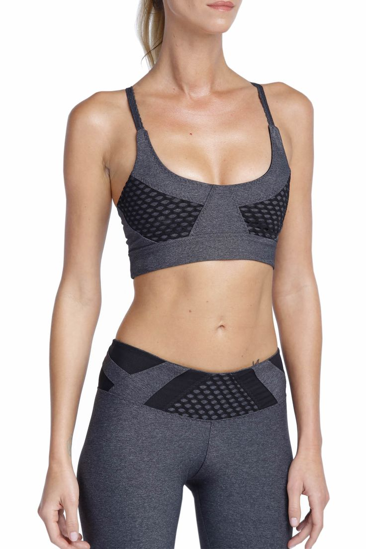 Bra top with molded cups and adjustable straps for customized fit. The hidden bra bands have hook-and-eye closures and the silicone band at the bottom hem ensures a stay-put fit. Great for layering under dance tops or embellishing.