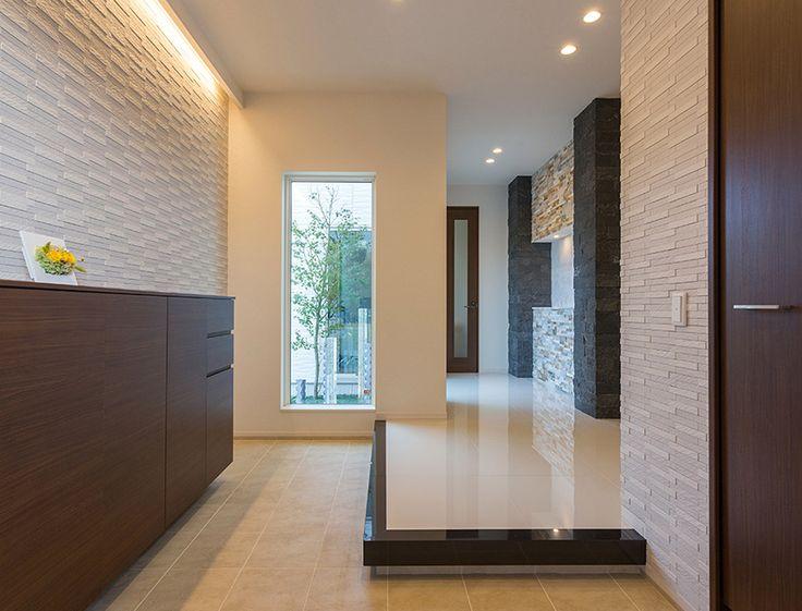 【公式:ダイワハウスの注文住宅サイト】建築事例・実例を住まい方別にご覧いただけます。「石張りの壁や坪庭がゲストを魅了する格調高い邸宅」