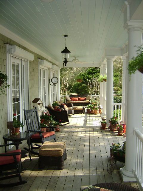 Reminds me of my sister's home..Love these wide porches. Notice the pale blue ceiling... old southern trick.. my painter did that at my house - no more wasp nests! Plus just lovelier to look at.
