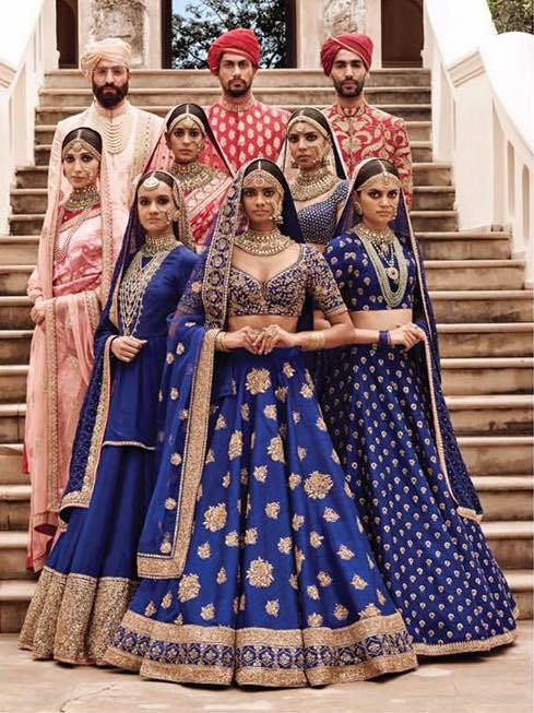 That blue lehenga in the front is perfect for your royal wedding reception look.