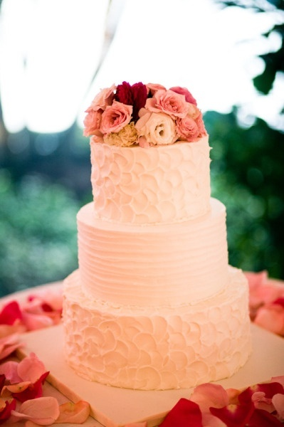 really pretty. textured cake, flowers on top, flower petals around base. Love the two different textures!
