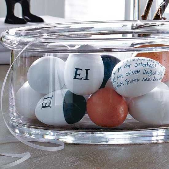 letters and words written on white easter eggs