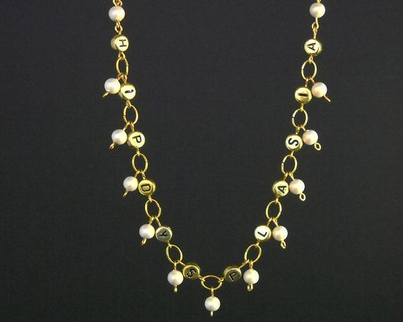 "Gold and white #Hip Dysplasia Awareness beaded necklace.  This #necklace features gold toned letter beads that spell out ""Hip Dysplasia"". It includes ""bone-colored"" glass pea... #jewellry #jewelery #accessories #gift #bone #pao #labrum #hip"