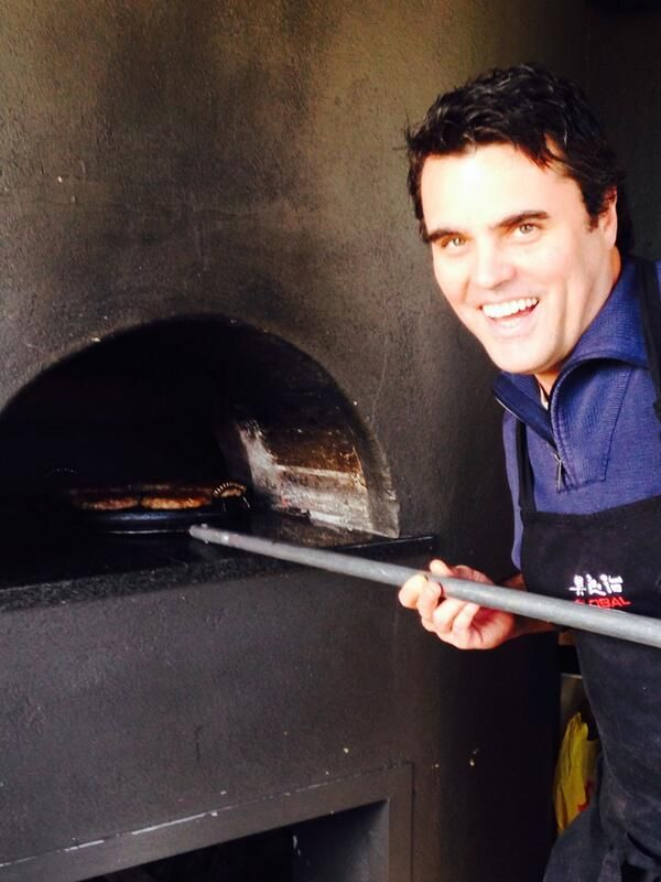 Peter Tempelhoff flippen a burger or 2 in the Mulderbosch pizza oven... exciting times ahead.