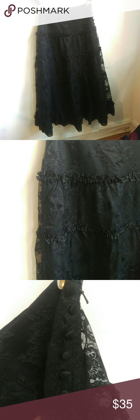 Black lace maxi skirt Black lace and ruffle maxi skirt. Has a hidden zipper on the side with decorative buttons. There's a snag and a couple small holes (pictured) that are not super noticeable when wearing  **10% off on bundles. All offers on single items considered** Goth punk emo scene gothic romantic sweet lolita vintage retro 80s 90s lace overlay kawaii rocker deathrock Express Skirts Maxi