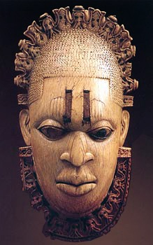 """This African mask is carved out of ivory for the """"Oba"""" (king) of Benin, and is believed to be dated from the 16th Century. This mask was actually not worn over the face, but rather as a pendant, either around the neck like a necklace or hanging from the king's hip, like a belt."""
