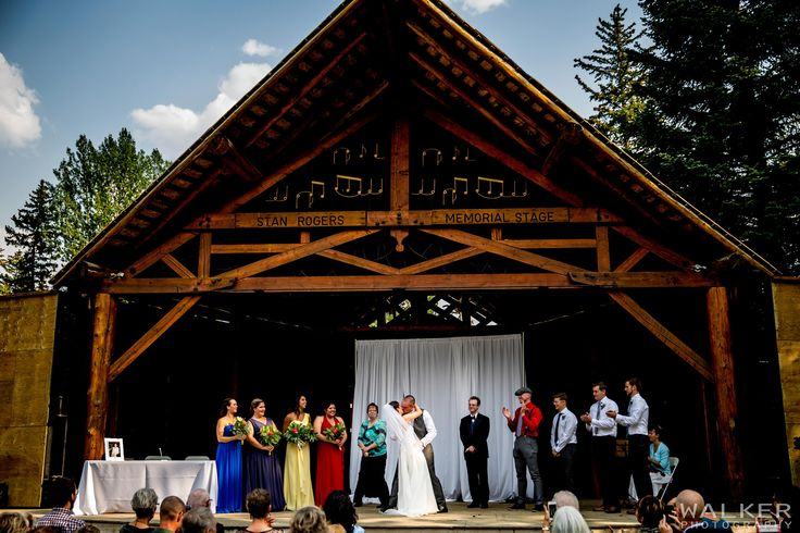 First Kiss at the Ceremony at Stan Rogers concert stage  Wedding Photography in Canmore Alberta    Walker Photography www.walkerphoto.ca