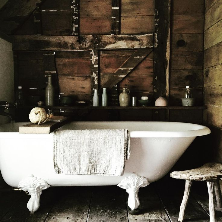 quite an achievement when you can give a sense of simple elegance to a most basic rustic space  ....... Bailey's home .... Bath time #home #bathtub #grainsack #milkingstool #linen #baileysbathsoak