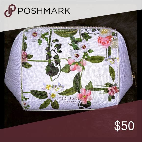Ted Baker London cosmetic bag Floral cosmetic bag by TED BAKER LONDON  -💯AUTHENTIC (NWOT) -gold logo emblem CHARM with 📌PLASTIC FILM still on📌 -small FAINT mark refer to last photo - colors: optic white shell,off white trim,pink,yellow & green -white shiny interior -floral designs on front & back -must have made a small mark on the interior when I tried to fit all my make up in so I'M SELLING THIS LOVELY COSMETIC CASE ONLY BECAUSE I HAVE TONS OF MAKE UP AND ONLY USE LARGE COSMETIC BAGS…