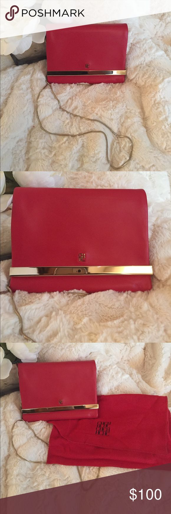 Carolina Herrera Red Purse Beautiful Carolina Herrera Red Evening Bag   New  Never Used   Softest Leather you've ever felt   Always Kept in Dust Bag   Gold Accents   Long Gold Shoulder Strap  Sits on Hip   Perfect for an evening out   👛.           *  I noticed the CH logo has tarnished a bit (most likely able to fix with polish ) & there is a slight dent in leather from chain (both in photos)    Make an Offer   Ask Questions Carolina Herrera Bags Shoulder Bags