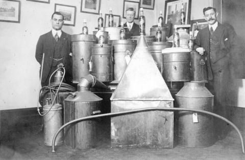 Liquor stills captured during Prohibition, 1917. (Photo by Vancouver Police Department, via Vancouver Archives)