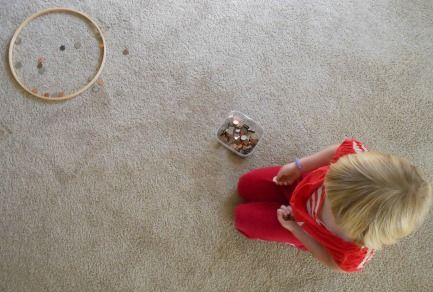 Coin Toss Game for teaching kids about money, add up what made it in the ring/basket