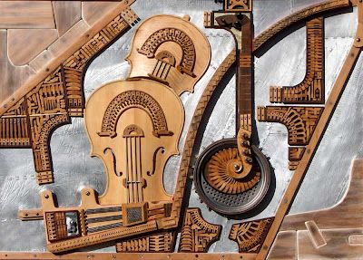 dismantled instruments reborn as beautifully interesting wall art