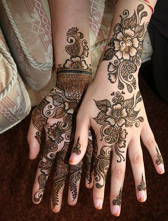 Henna tattoo. Different intensity of patterns on the palm to the back of the hand. http://picturestattoos.blogspot.co.uk