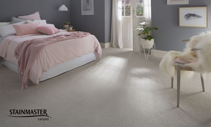This gorgeous combination of pale whites and cream textured (hard twist) cut pile carpet, grey walls and pastel pink accents creates a beautiful feminine bedroom. With the refreshed STAINMASTER® EverSoft® SDN carpet range anyone can find their colour. #colour #inspiration #bedroom