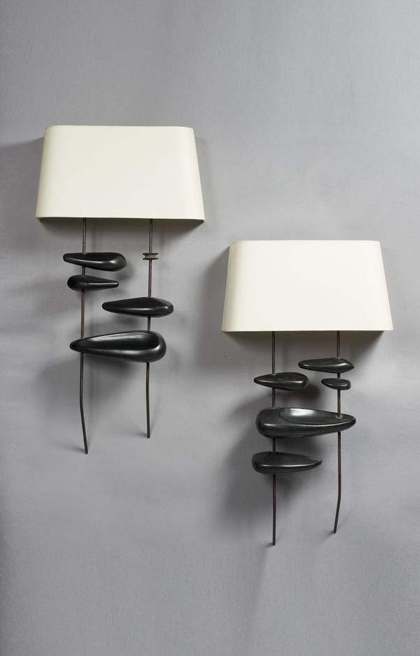 GEORGES JOUVE, Ceramic Wall Lights, France, c.1950s. Material brass, glazed earthenware with cellulose shades. / Piasa