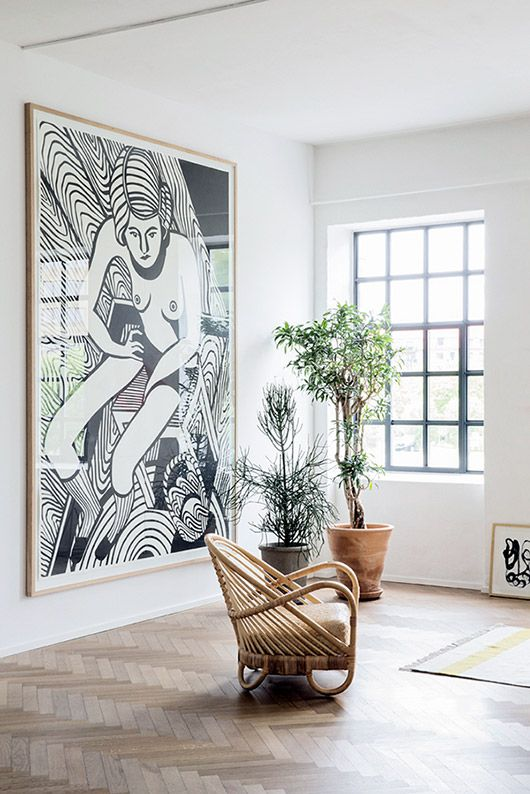 Wicker chair plants, and an oversized black-and-white piece, photographed by Heidi Lerkenfeldt.