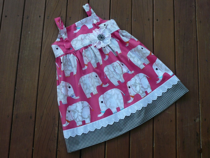 """It's so cute.  This little pinafore with knotted straps made from Dear Stella designed fabric.  """"Ellie's playdate.""""  http://www.facebook.com/MamasLoveChildrensClothingAndAccessories"""