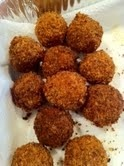 Gianna's homemade boudin balls -- cajun sausage, rice and seafood fried in panko bread crumbs. Yes!