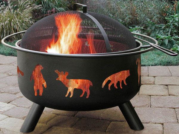 Price: $121 With a quality build and classic design, the Landmann Big Sky is a great choice for your backyard or a camping trip. The Big Sky includes a spark screen, a poker, and a full-size cooking grate with handle for whipping up great meals on the fire. Add the optional fire-pit cover to protect your fire pit from the elements. At 32 pounds and 23.5 inches in diameter, it's practical to lug around.    - PopularMechanics.com