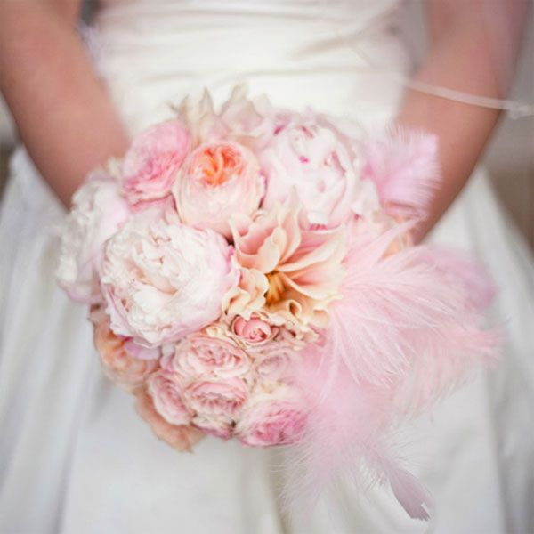Light pink feathers perfectly complement the lush feel of this peony bouquet.Photo by: Amy Stone Photography on Style Unveiled via Lover.ly
