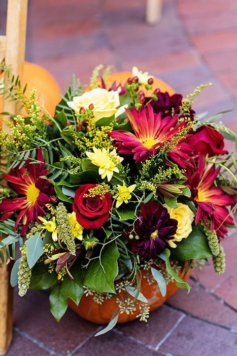 Pumpkin decor overflowing with whimsical fall floral at a Disneyland wedding ceremony
