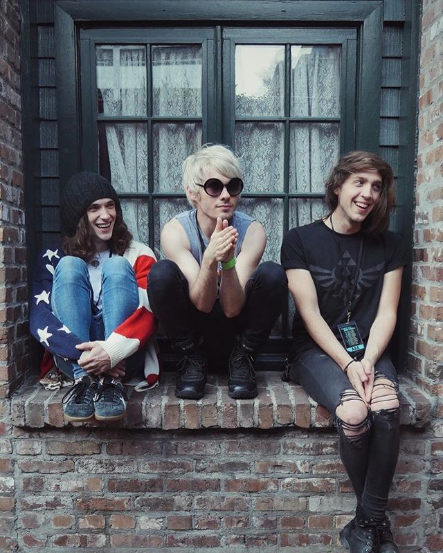 three band members sitting on a wall. three band members sitting on a wall, and if one falls off... then there's hell to pay for whoever pushed them off<<uh