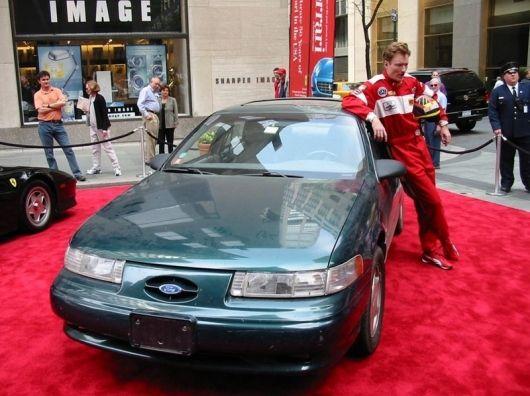 Conan O'Brien and his 1992 Ford Taurus SHO