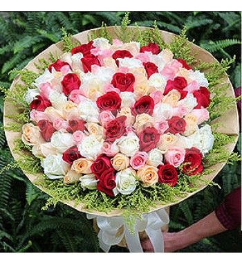 Assorted bouquet of colorful roses wrapped in premium paper packing with seasonal foliage. #MumbaiFlorist #CityFlowers #FlowersDeliveryIndia #EasyFlowers