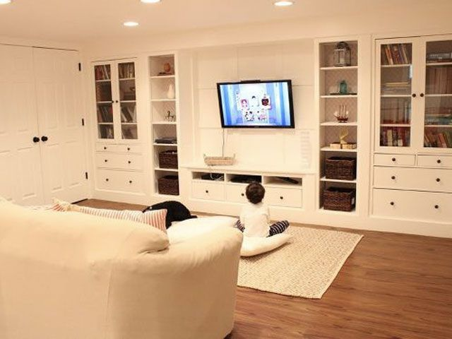 Installing bright-white Ikea built-ins took this basement from stark to sleek, adding even more living space to the home of the blogger behind No. 29 Design. See more of this project at HomeTalk. RELATED:  Smart Storage Units For Your Home's Nooks and Crannies     - HouseBeautiful.com