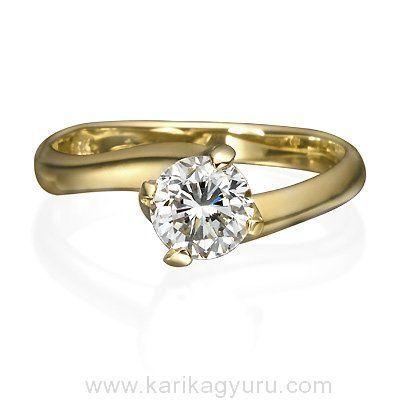 Karikagyűrű Áruház Klasszikus, csavart egy köves eljegyzési gyűrű négy karmos 18K matt-sárga arany foglalatban igény szerint 0,60ct-1,00ct súlyú briliánssal.