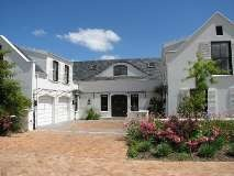 This beautiful house has everything you need it in a beautiful secluded estate. Located in the amazing De Zalze Golf Estate, the house has 5 bedrooms, 4 bathrooms and 2 garages. This is the SMART MOVE for a home away home.