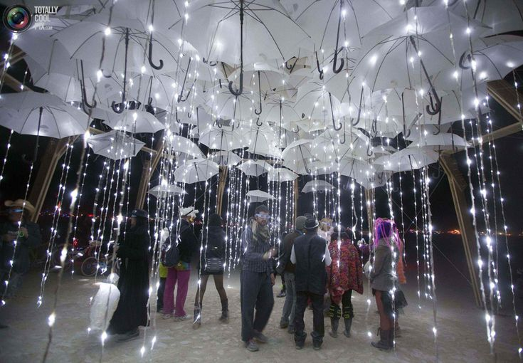 Burning Man Wedding. nice idea - umbrella canopy with string lights. wish this was a first dance picture!