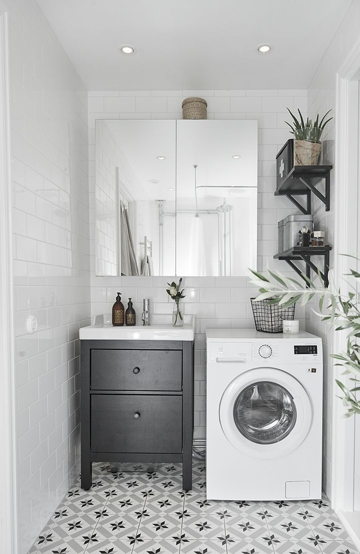 Great idea to have the black vanity cabinet with white tiles on the walls and the european tiles on the floors. This could be a great idea for our laundry.