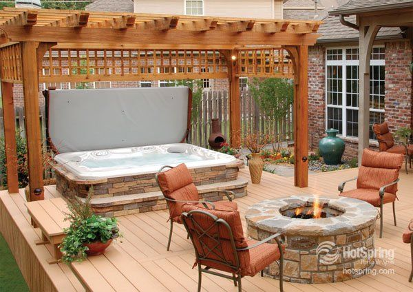 Beautifully coordinate hot tub and fire pit — this would be great for cozy, outdoor entertaining on summer nights or throughout the winter!