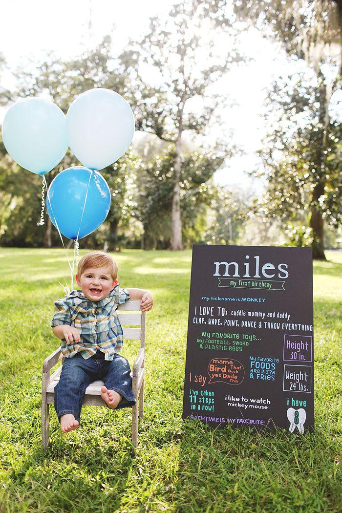 baby boy one year birthday smash cake cardboard sign balloons