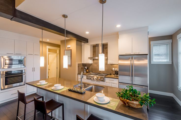 Large Contemporary kitchen space with Island and countertop lighting.
