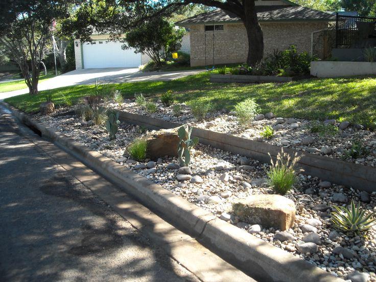 Front yard landscape native plantings large boulders for Large river rock landscaping
